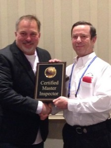 Yuri Olhovsky receives a Certified Master Inspector award from  Executive Director of the Master Inspector Certification Board Nick Gromicko